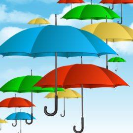 Umbrellas floating in blue sky